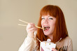 eating redhead woman