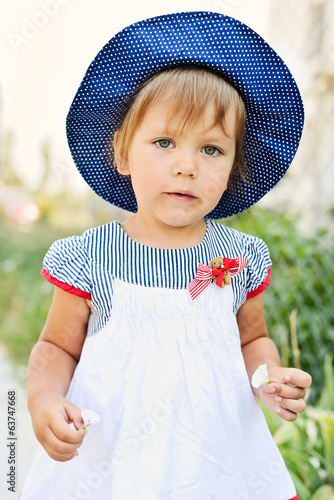 toddler with little flowers