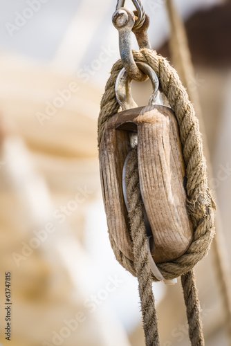Wooden pulley on old yacht.