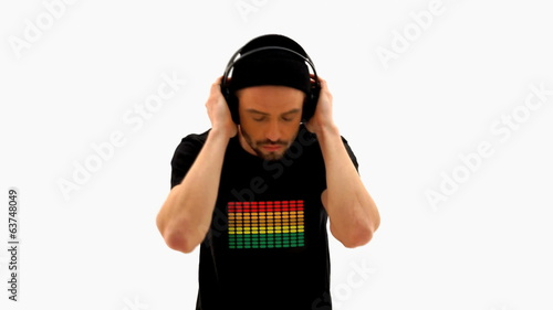 man wearing headphones and t-shirt on white