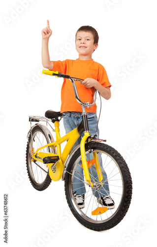 boy on bicycle point at