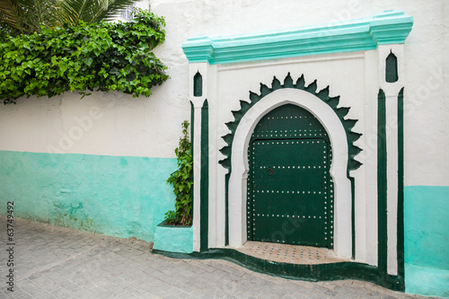 Green wooden gate of ancient mosque in Medina. Tangier, Morocco