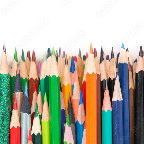 Sharp colorful pencils. Macro photo background on white backgrou
