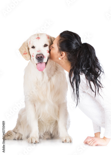 girl kissing a dog