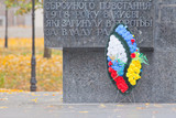 World War II memorial with wreath poster