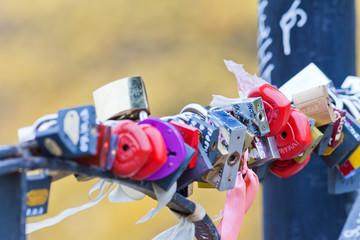 Many marriage love symbol padlocks chained on bridge