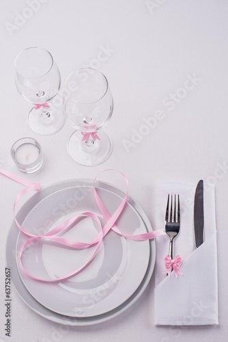 White and pink festive table set for restaurant menu