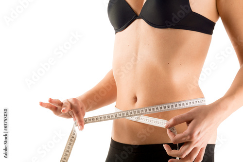 waist measurement of girl - isolated