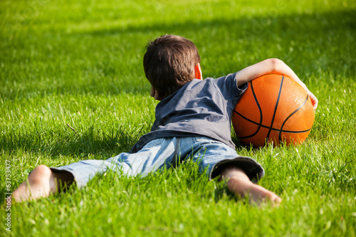 Boy laid down on the grass