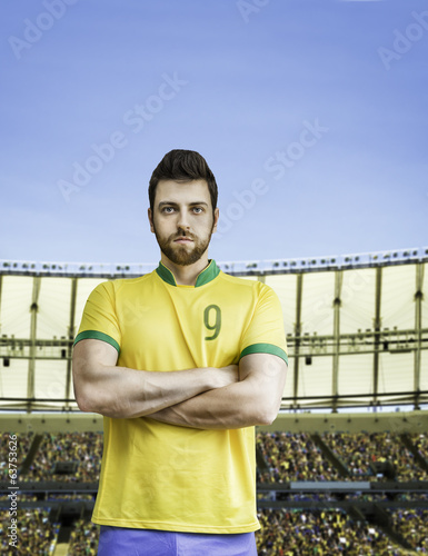 Brazilian soccer player looks serious on the stadium
