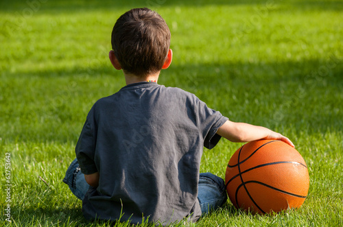 Boy sitting on the grass