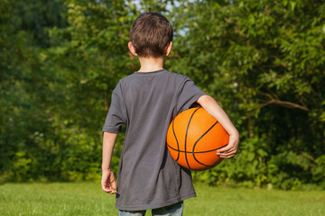 Standing boy with ball