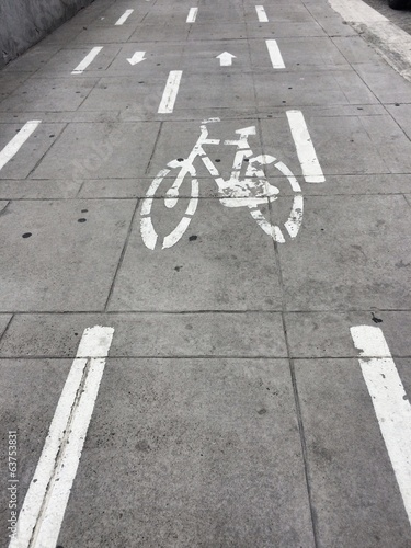 Bike sign on the sidewalk