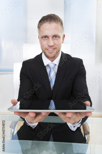 Businessman holding a tablet computer in his hands