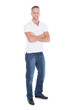 Confident sexy attractive young man in jeans and a t-shirt