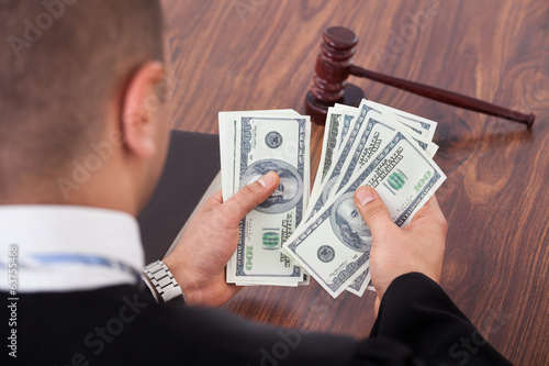 Judge Counting Dollars In Courtroom