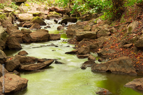 landscape of flowing water and stones