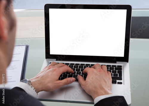 Cropped Image Of Businessman Using Laptop At Desk