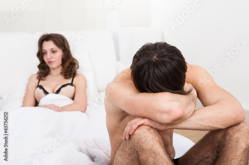 Sad Couple On Mattress After Argument