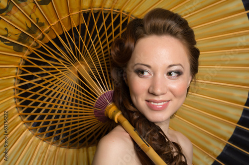 Girl with traditional Japanese umbrella