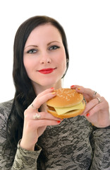 Woman holding hamburger. Isolated