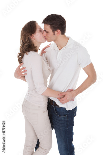 Passionate Couple In Casuals Kissing Each Other