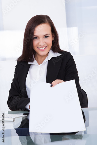 Businesswoman Giving Papers