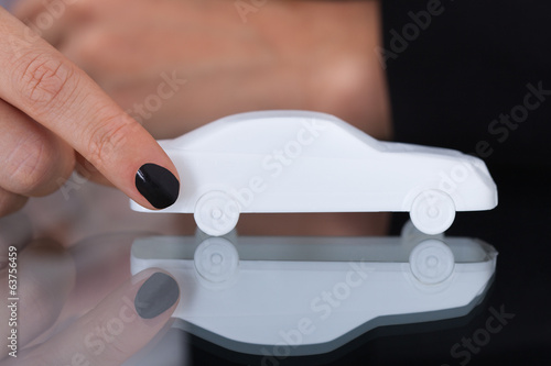 Businesswoman Holding Toy Car