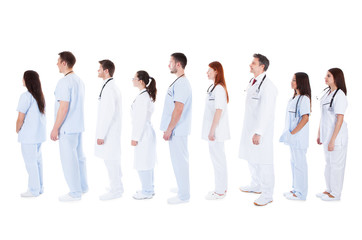 large group of medical staff standing in a queue