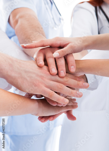 Medical team stacking hands