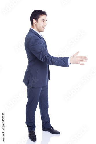 Business man with hand extended to handshake, isolated on white