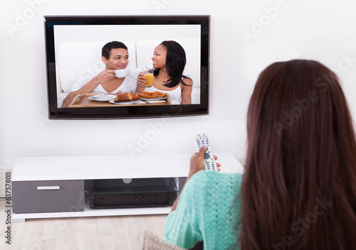 Woman Watching TV In Living Room
