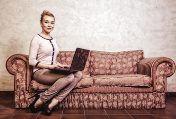 Businesswoman using computer. Internet at home. Vintage photo.