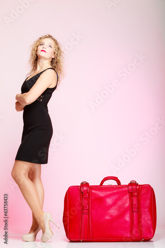Full length lady in voyage, traveler woman with old red bag