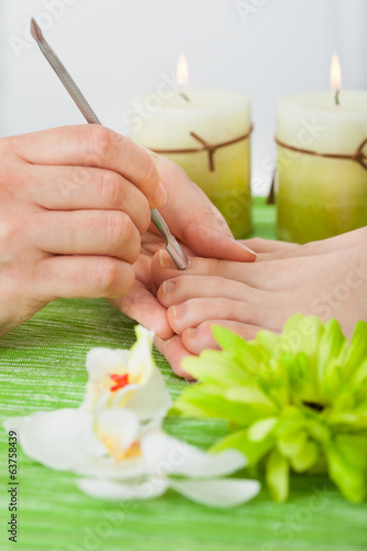 Beautician Giving Pedicure Treatment