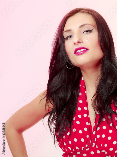 Portrait pinup girl brunette woman in retro red dress. Vintage.