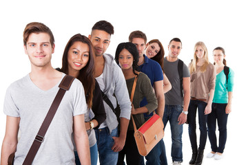 Confident College Students Standing In A Queue