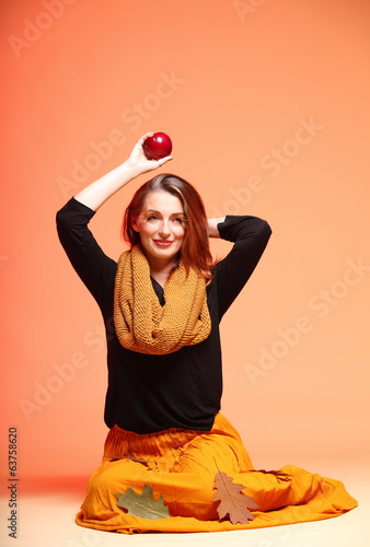 Autumn fashion girl with apple orange eye-lashes