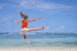 flying jumping beach girl at blue sea shore in summer vacation i