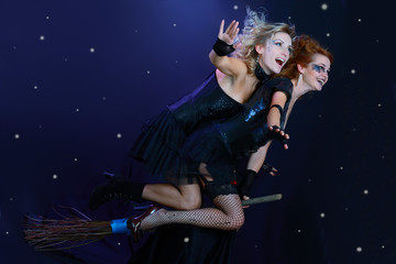 two witches flying on broom