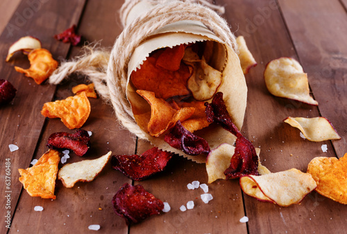 Vegetablein paper wrap on a rustic wooden background
