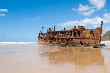 The wrck of the Maheno lies rusting away at the high tide line.