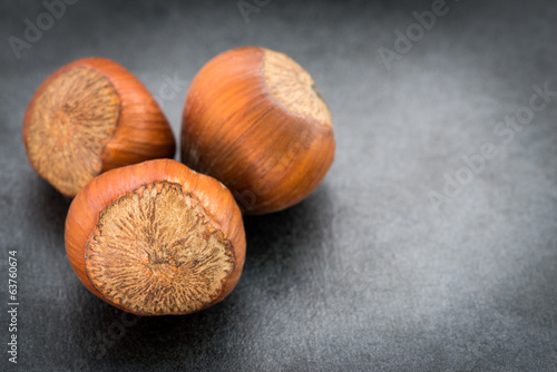 Hazelnuts on a dark background. Selective focus.
