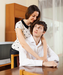 Man has problem, young woman comforting him