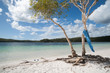 Blue towel blows in breeze and sandals of  Lake McKenzie