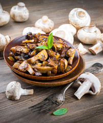 Fresh champignons on a wooden board