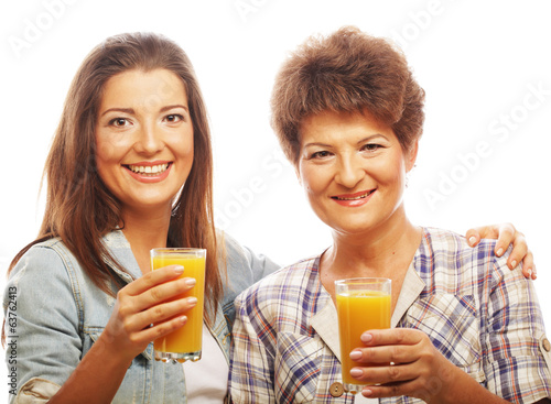 mature mother and yung daughter with juice