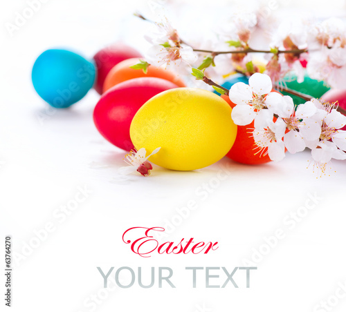 canvas print picture Easter. Colorful easter eggs with spring blossom flowers