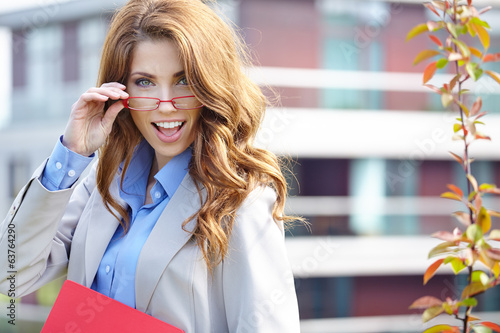 Young businesswoman (real estate agent) presenting detached mode