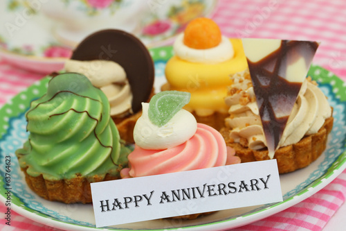 Happy Anniversary card with selection of cream cakes
